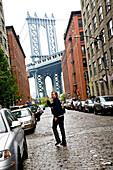 Young man near Brooklyn bridge, Dumbo, Brooklyn, New York City, USA