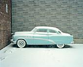 Blue Buick car in snow, Brooklyn, New York City, New York, USA