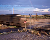 Blurred train on railroad crossing, Texas, USA