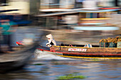 Speeding boat in Mekong Delta, blurred motion, Vinh Long, Vietnam