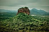 Sigiriya rock fortress rises straight out ot the jungle, cultural triangle, Sri Lanka, UNSCEO world heritage