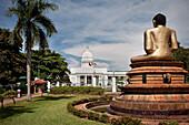 City Hall in Colombo with Buddha figure at Victoria Park, capital, Sri Lanka