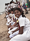 Smiling tamil school kids at beach Galle Face Green in the city, Colombo, Sri Lanka