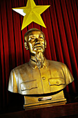 Sculpture of Uncle Ho in front of Vietnamese Flag at Reunification Palace, Saigon, Ho Chi Minh City, Vietnam
