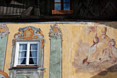 Traditionally painted exterior wall with depiction of a holy person, Mittenwald, Bavaria, Germany
