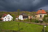 Graefinthal with rest of former Wilhelmiten monastery under thunder clouds, Mandelbachtal, Bliesgau, Saarland, Germany, Europe