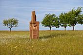 Agricultural landscape with sculpture, Skulpturenstraße, Steine an der Grenze, Near Scheuerwald, Saarland, Germany, Europe