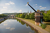 View of crane Saarkran and Old Bridge at the river Saar in the sunlight, Saarbruecken, Saarland, Germany, Europe