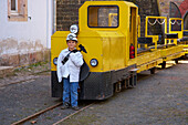Child in front of the Rischbachstollen, former coalmine that's open to the public, St. Ingbert, Saarland, Germany, Europe