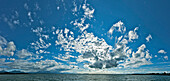 Mood of clouds above lake Chiemsee, Chieming, Chiemgau, Upper Bavaria, Germany