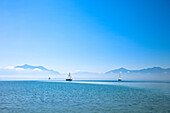 Sailboat on lake Chiemsee, lido Seebruck, Chiemgau, Upper Bavaria, Germany