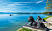 View over lake Starnberg to snow-covered Alps, lion sculptures in foreground, Tutzing, Upper Bavaria, Germany