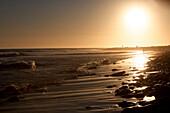 Sea surf at sunset, Los Angeles, California, USA