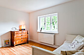 Bedroom with Bed and chest of drawers, House furnished in country style, Hamburg, Germany
