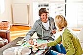 Young couple playing monopoly, Hamburg, Germany