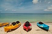 Sea Kayaks on beach in Roatan Island, Honduras.