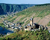 Germany, Cochem, Moselle, Moselle valley, Rhineland-Palatinate, panoramic view, Moselle landscape, vineyards, mountain range of the Eifel, Reichsburg Cochem, imperial castle, Gothic Revival, in the background church Saint Remaclus, catholic church. German