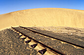 Namibia - Rails and shifting dune barchan dune east of Lüderitz