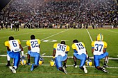 Florida, Miami, Miami Dade College North Campus, Traz Powell Stadium, high school football playoff game, Northwestern vs  Central, Black, players, student, teen, sideline, watching