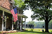 Pennsylvania, Kintnersville, Route 611, Trauger´s Farm Market, farmhouse, family-owned business, agriculture, agritourism, agricultural land preservation, economic development, porch, tree, clothesline, laundry, American flag, Delaware River Valley