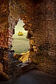 composit of opening in brick wall showing saill boat