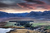 Lake Heron Station at dusk, Arrowsmith Mountains on left, Rakaia River Valley in far distance, Canterbury