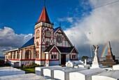 Rainbow over Maori owned Church of St Faith, Ohinemutu, Rotorua.