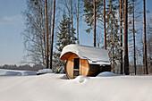 Round Barrel Sauna in the Snow, Valga County, Estonia