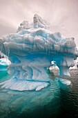 Eroded iceberg with icicles, Pleneau Island, Antarctic Peninsula.