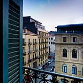 Urban Street Scene Viewed Through Apartment Window, San Sebastian, Spain