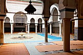 Islamic worshippers cleanse themselves at an ablution fountain in a mosque in the medina, old city of Fes, Morocco