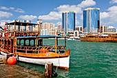 Rustic riverboats on Dubai Creek in Dubai, UAE, Persian Gulf.