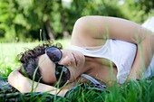 20's, adult, country, flower, forest, fresh, girl, grass, grassland, green, holiday, lying down, mountain, nature, rest, shade, sleep, spring, summer, sunglass, teenager, woman, young, young adult, youngster, L55-1332035, AGEFOTOSTOCK