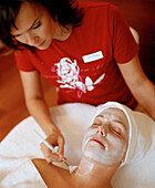Woman having facial treatment, Spa Resort, Travemuende, Luebeck, Schleswig-Holstein, Germany