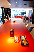 Table with drink and sushi, CanteenM at Citizen M Hotel, Amsterdam, Netherlands