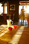 Steaming tea and apples on the table of the Panorama Room, Ecohotel Grafenast, Am Hochpillberg, Schwaz, Tyrol, Austria