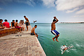 Boys jumping in the water, Corralejo, Fuerteventura, Canary Islands, Spain