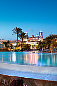 An Hotel with pool in the evening, Meloneras, Maspalomas, Gran Canaria, Canary Islands, Spain, Europe