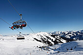 Skier in the chair lift, Ski Resort Pengelstein, Lift, Kirchberg, Kitzbuhel, Tyrol, Austria