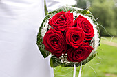 Bouquet of red roses, white bridal gown, wedding gown, flowers, wedding, Leipzig, Saxony, Germany
