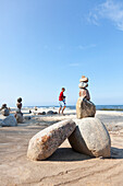 Father and son playing on the beach next to a pile of stones, cairns, Baltic Sea, MR, Bansin, Island Usedom, Mecklenburg-West Pomerania, Germany
