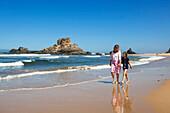 Mother and daughter strolling along the beach Praia da Castelejo, Atlantic Coast, Algarve, Portugal, Europe