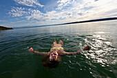 Girl swimming in Lake Starnberg, Bavaria, Germany