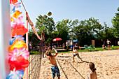 Teenagers playing beach volleyball at Lake Starnberg, Upper Bavaria, Germany, Europe