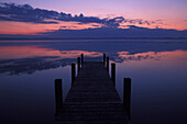 Pier at lake Starnberg in the afterglow, Upper Bavaria, Germany, Europe