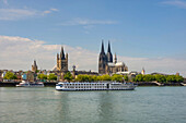 View at the Cologne Cathedral with Rhine and a tourist boat, Cologne, North Rhine Westphalia, Germany