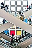 People, business people on escalators, Berlin Exhibition, Berlin, Germany