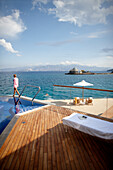 Woman at the pool and deck of the Yachting Club Villas, Elounda Beach Resort, Elounda, Crete, Greece