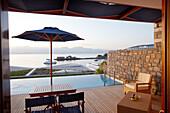 View over a swimming pool to Mediterranean Sea in the morning light, Elounda, Agios Nikolaos, Crete, Greece