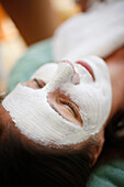 Woman with facial mask, Pflersch, Gossensass, South Tyrol, Italy